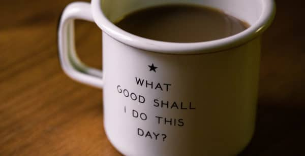 White coffee cup that reads 'what good shall I do this day?'