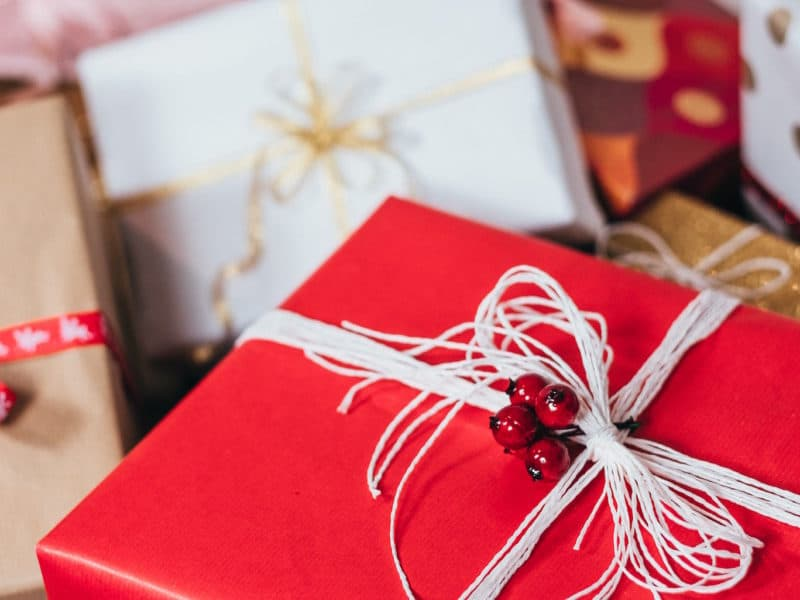Holiday gifts wrapped in red and white paper.